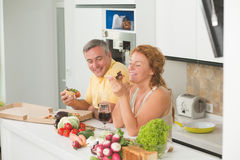 Middle-aged couple in the kitchen Stock Photo