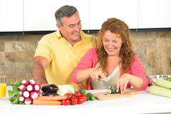 Middle-aged couple in the kitchen royalty free stock photos