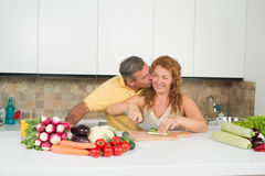 Middle-aged couple in the kitchen Royalty Free Stock Photo