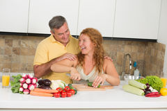 Middle-aged couple in the kitchen Royalty Free Stock Photography