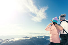 Middle aged couple looking away on the top of the mountain Royalty Free Stock Photos