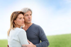 Middle-aged couple looking towards future. Peaceful middle-aged couple in countryside Royalty Free Stock Photography