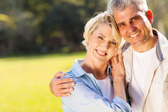 Middle aged couple. Loving middle aged couple hugging outdoors royalty free stock photo