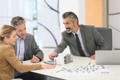 Middle-aged couple meeting architect in office Stock Photography