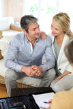 Middle-aged couple meeting finnacial advisor at home Stock Photography