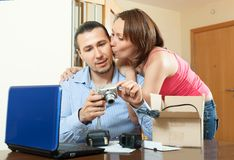 Middle-aged couple with new digital camera Stock Images
