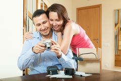 Middle-aged couple with new digital camera at home Stock Photos