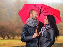 Middle-aged couple outdoors on nautumn day Stock Photos