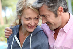 Middle-aged couple outdoors smiling Royalty Free Stock Images