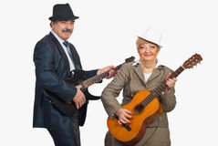 Middle aged couple playing guitars Royalty Free Stock Photo