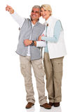 Middle aged couple pointing Royalty Free Stock Photography