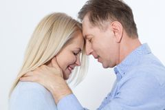 Middle aged Couple portrait isolated on white background. Beautiful Middle aged Couple portrait isolated on white Royalty Free Stock Photos