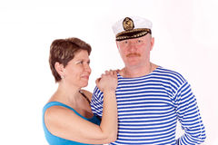Middle aged couple posing as sailors Stock Images