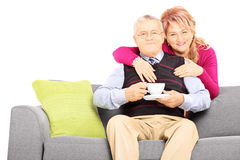 Middle aged couple posing during a coffee break. Isolated on white background Stock Photo