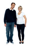 Middle aged couple posing with hand in hand royalty free stock image