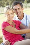 Middle Aged Couple Relaxing In Countryside Stock Photos