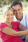 Middle Aged Couple Relaxing In Countryside Stock Images