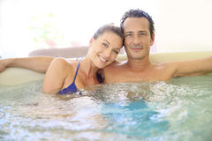 Middle aged couple relaxing and enjoying the jacuzzi Royalty Free Stock Photos