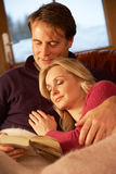 Middle Aged Couple Relaxing On Sofa Stock Images