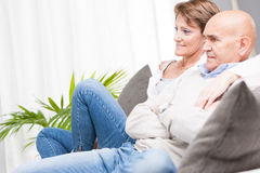 Middle-aged couple relaxing watching television Royalty Free Stock Images
