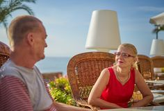 Middle Aged Couple Seafront Terrace Stock Photos