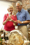 Middle aged couple shopping for antiques Royalty Free Stock Images