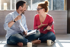 Middle-aged couple sitting on floor near window Royalty Free Stock Images