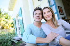 Middle-aged couple sitting in their garden Stock Image
