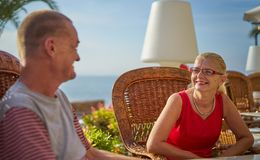 Middle Aged Couple Together on Seafront Terrace Stock Images