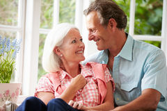 Middle Aged Couple Sitting On Window Seat Together Royalty Free Stock Photo