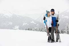 Middle Aged Couple On Ski Holiday In Mountains Royalty Free Stock Photos