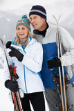Middle Aged Couple On Ski Holiday In Mountains Stock Image