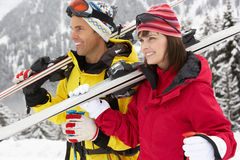 Middle Aged Couple On Ski Holiday In Mountains Royalty Free Stock Photo