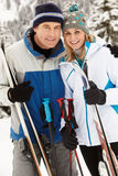 Middle Aged Couple On Ski Holiday In Mountains Stock Photos