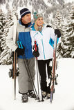 Middle Aged Couple On Ski Holiday In Mountains Stock Images