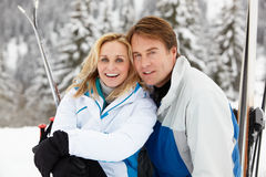 Middle Aged Couple On Ski Holiday In Mountains Stock Photography