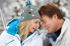 Middle Aged Couple On Ski Holiday In Mountains Royalty Free Stock Images