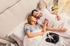 Middle-aged couple slumbering at bedroom Royalty Free Stock Image