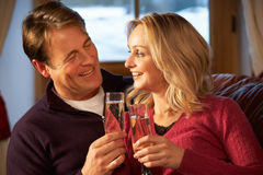 Middle Aged Couple On Sofa With Champagne Stock Photography