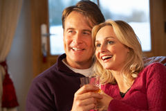 Middle Aged Couple On Sofa With Whisky Stock Photos