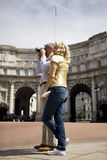A middle-aged couple standing by Admiralty Arch, taking a photograph Royalty Free Stock Photography