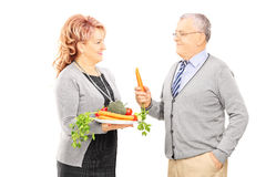 Middle aged couple standing close together and holding a healthy Royalty Free Stock Photo
