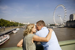 A middle-aged couple standing near the London Eye, embracing Royalty Free Stock Photography