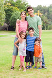 Middle aged couple standing with their children Royalty Free Stock Image