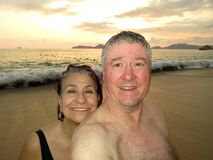 Middle Aged Couple at Sunset in Acapulco stock photography