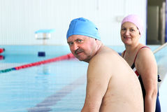 Middle Aged Couple In Swimming Pool Royalty Free Stock Image