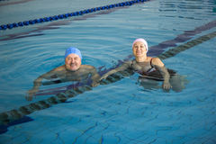 Middle Aged Couple In Swimming Pool. Middle Aged happy Couple In Swimming Pool Royalty Free Stock Image