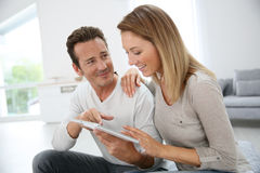 Middle-aged couple with tablet royalty free stock images