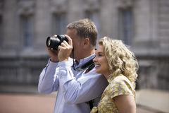 A middle-aged couple taking a photograph Royalty Free Stock Photography
