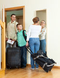 Middle-aged couple with teenage with suitcases near door at home Stock Images
